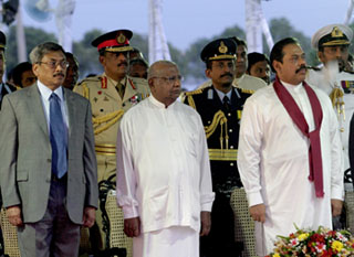 Right to left: President Mahinda Rajapaksa, Prime Minister Ratnasiri Wickramanayake, and Defense Secretary Gotabhaya Rajapaksa in June 2008. (Reuters/Buddhika Weerasinghe)