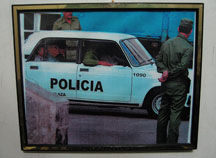 A photo of police taking away Espinosa Chepe hangs in his home.