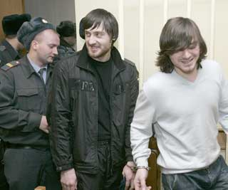 Defendants in the Politkovskaya murder walk out of court after their recent acquittal.  (Reuters)