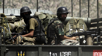 Pakistani soldiers on their way to Buner. (AP/Mohammad Sajja)