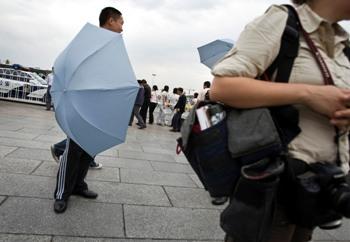 Umbrella censors in Tiananmen Square on June 4. (AP)