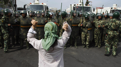 Uighur journalists who covered protests such as this one in 2009 were sentenced to harsh prison terms. (AP)