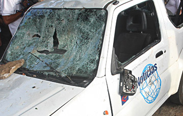 A news vehicle was targeted by vandals during election unrest. (AP)