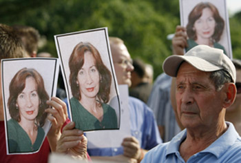 Supporters hold photos of Estemirova at a remembrance in Moscow. (Reuters/Denis Sinyakov)