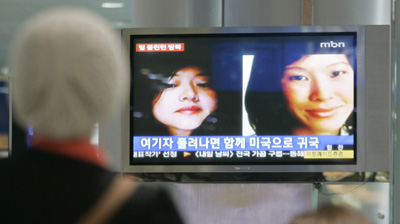Television reports in South Korea. (AP)