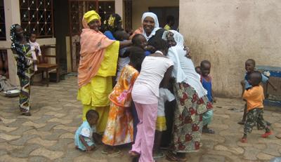Sarata Jabbi-Dibba's family rejoices as she returns home. (The Point)