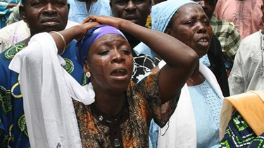 Mourners at Bayo Ohu's funeral. (The Vanguard)