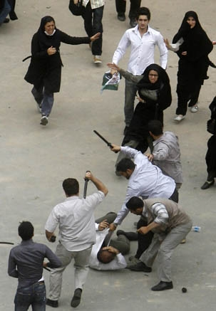 Security agents in Tehran beat a demonstrator in the aftermath of the contested June elections. (AFP)