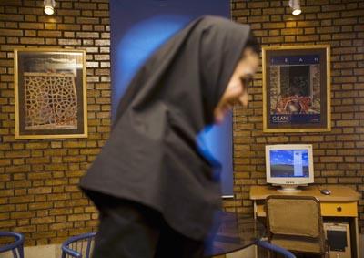 A woman at an Internet café west of Tehran. (Reuters)