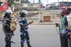 Riot police confront journalists in Libreville during an August opposition protest. (Andriankoto Ratozamanana)