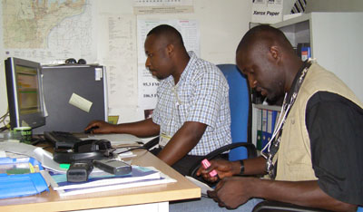 Didace Namujimbo, right, with colleague Serge Maheshe at Radio Okapi offices in 2006. Both were later murdered. (Déo Namujimbo)