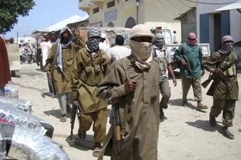 Al-Shabaab militants patrol Bakara market. (Reuters)