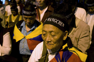 In Dharamsala, India, exiled Tibetans hold a vigil for the jailed filmmaker Dhondup Wangchen. (AP/Ashwini Bhatia)