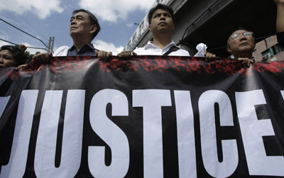 Journalists march in Manila. (AP/Bullit Marquez)