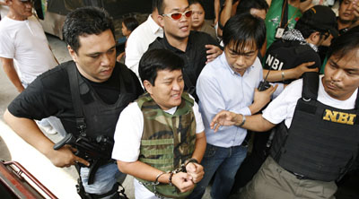 Andal Ampatuan Jr., a defendant in the killings, is taken to court in Manila. (Reuters/Roi Azure)