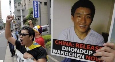 Demonstrators demand the release of documentary filmmaker Dhondup Wangchen, jailed in China after interviewing Tibetans. (AFP)