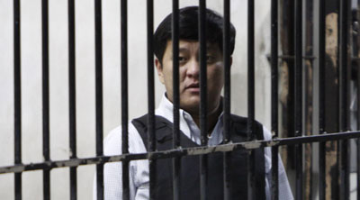 Local politician Andal Ampatuan Jr. has been charged in the killings, but roughly 100 gunmen have not. (AP/Pat Roque)