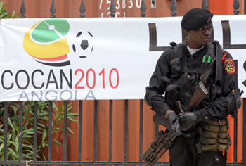 A soldier stands guard before an African Nations Cup banner. (AFP)