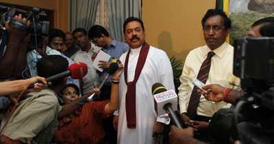 Mahinda Rajapaksa talks to reporters after being declared the victor in the country's presidential vote. (AP/Eranga Jayawardena)