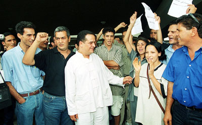 Ben Brik, center, after ending a six-week hunger strike to protest Tunisia's human rights record in 2000. (AFP)