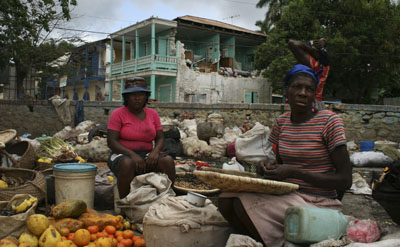 Women sell fruit in Jacmel, where Radio Fondwa was completely destroyed along with much of the city's downtown. (AP)
