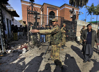 Soldiers secure the Peshawar Press club after a suicide bombing in December. (Reuters/Fayaz Aziz)