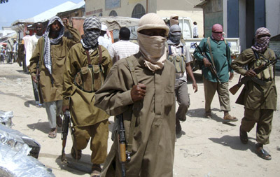 Al-Shabaab militants patrol Mogadishu's Bakara Market, home to several media outlets. (Reuters/Feisal Omar)
