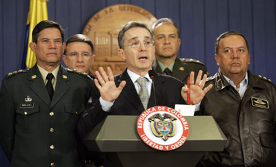 Colombian President Álvaro Uribe Vélez appears at a press conference with military leaders to announce the end of unlawful spying. (AP/Fernando Vergara)