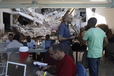 Foreign journalists, seen here working in Port-au-Prince, have flooded into Haiti after the earthquake, but the local media is in tatters. (Reuters/Eliana Aponte)