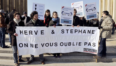 A rally in Paris seeks to publicize abductions. (AFP)