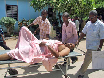Hashi is taken to a hospital after being shot by Al-Shabaab militants in June 2009. His colleague Mukhtar Mohamed Hirabe was killed in the attack. (AP)
