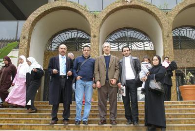 At the Casablanca Appeals Court, left to right: Driss Chahtan's lawyer, Said Ben Hommani; Al-Mishaa's Mustapha Rayhan; Kamel Labidi; Al-Mishaal's Hassan Ain al-Hayat; Chahtan's wife, Sihem, and daughter, Saberina. (CPJ)