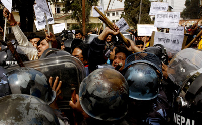 Nepalese riot police block journalists during a protest against the killing Arun Simhaniya. (AP/Binod Joshi)