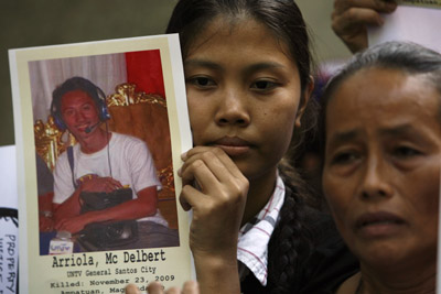 The wife of McDelbert Arriola, slain in Maguindanao. (Reuters/Romeo Ranoco)