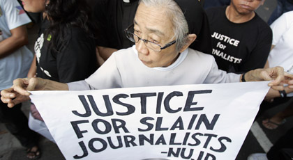 Protesters in Manila seek justice in the Maguindanao massacre. (Reuters/Romeo Ranoco)