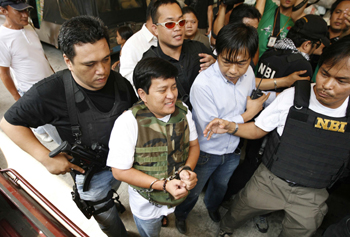 Andal Ampatuan Jr., a local mayor and chief suspect in the Maguindanao massacre, is led into court in Manila. (AP)