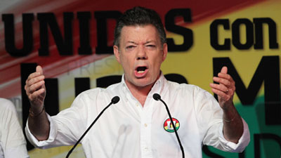 The government barred some news coverage of the first round of voting, won by Juan Manuel Santos. (AP/Fernando Vergara)