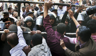 Police clash with protesters and journalists during a Cairo rally last month. (AP)