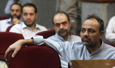 Columnist Ahmad Zaid-Abadi, foreground, at a mass, televised judicial proceeding in 2009. (Reuters)