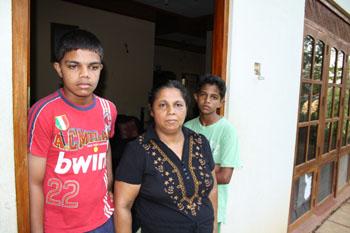 Sandhya Eknelygoda and her two sons. (CPJ/Bob Dietz)