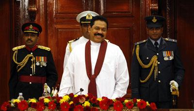 President Mahinda Rajapaksa at the swearing-in ceremony for his cabinet. (AP/Eranga Jayawardena)
