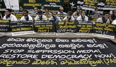 At a March rally in Colombo, protesters seek restoration of free expression. (AP/Chamila Karunarathne)