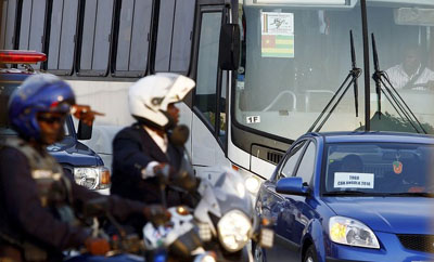Angolan police escort the Togolese team bus in the aftermath of the deadly attack. (Reuters/Amr Abdallah Dalsh)