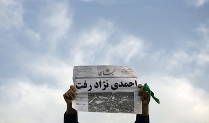 A supporter of former presidential candidate Mir-Hossein Mousavi holds an anti-Ahmadinejad newspaper during a Tehran rally in June 2009. (Morteza Nikoubazl/Reuters)