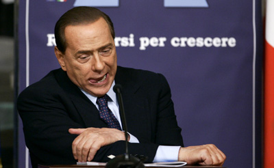 Berlusconi finds a wiretap bill more difficult to pass than expected. (AP/Riccardo De Luca)