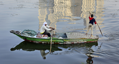 Fishermen on the Nile, where chemical dumping has been reported. (AP/Ben Curtis)