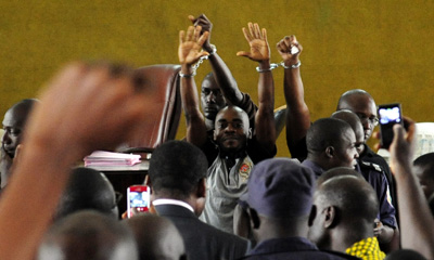 The three defendants handcuffed in court prior to their release. (AFP/Issouf Sanogo)