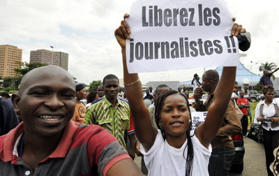 Protesters seek release of three Ivorian editors jailed in a leaked document case. (AFP/Sia Kambou)