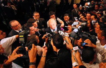 The OAS can play a key role in reversing abuses in Honduras. OAS Secretary-General José Miguel Insulza speaks with reporters in Tegucigalpa. (AP/Eduardo Verdugo)