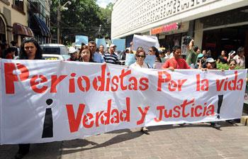 Protesters in Tegucigalpa decry violence against journalists. (AP/Fernando Antonio)
